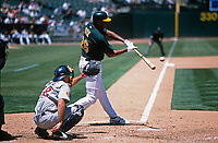 OAKLAND, CA - Jermaine Dye of the Oakland Athletics bats against the Minnesota Twins at the Oakland Coliseum in Oakland, California in 2001. (Photo by Brad Mangin)