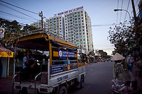Motorbikes drive past the Hoang Anh  building on Le Van Luong street in District 7 in Ho Chi Minh City, Vietnam...Photo taken Wednesday, November 11, 2009. Kevin German / Luceo Images