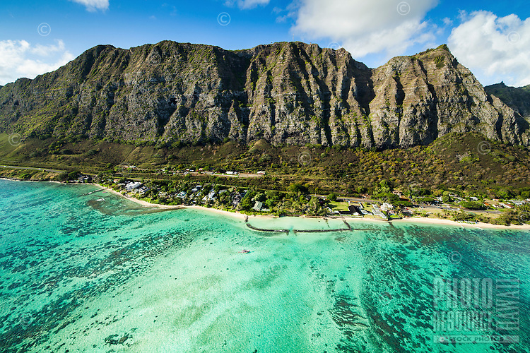 An aerial view of Waimanalo Beach, with the majestic Ko'olau Range towering over it on O'ahu.