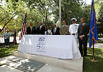 Diginitaries unveil the restored memorial during the USS Nevada Centennial of Launch ceremony at the Capitol, in Carson City, Nev., on Friday, July 11, 2014.<br /> Photo by Cathleen Allison