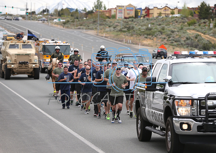 Carson City Sheriff's run the final leg of a 450-mile Nevada Law Enforcement Memorial Run from Las Vegas to Carson City, Nev. on Wednesday, May 4, 2016, in honor of Carson City Sheriff's Dep. Carl Howell, who was killed in the line of duty in Aug. 2015.<br /> Photo by Cathleen Allison