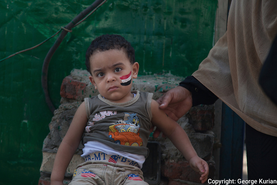 Scenes outside a polling station in Shubra, Cairo. <br />