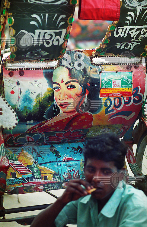 Dhaka is a city of over 600,000 rickshaws. The drivers - rickshaw wallahs - are mostly migrants from the countryside. Their vehicles are lovingly decorated with images of sports cars, dream homes, idealised rural scenes and movie stars.