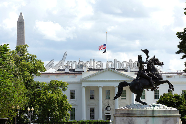 The White House is seen in Washington D.C., U.S., on Saturday, May 23, 2020.  United States President Donald J. Trump ordered American flags to be flown at half-staff until May 24, 2020 to honor the victims of COVID-19.  Credit: Stefani Reynolds / CNP/AdMedia