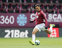 Burnley's Dwight McNeil during the pre-match warm-up <br /> <br /> Photographer Rich Linley/CameraSport<br /> <br /> The Premier League - Saturday 13th April 2019 - Burnley v Cardiff City - Turf Moor - Burnley<br /> <br /> World Copyright © 2019 CameraSport. All rights reserved. 43 Linden Ave. Countesthorpe. Leicester. England. LE8 5PG - Tel: +44 (0) 116 277 4147 - admin@camerasport.com - www.camerasport.com