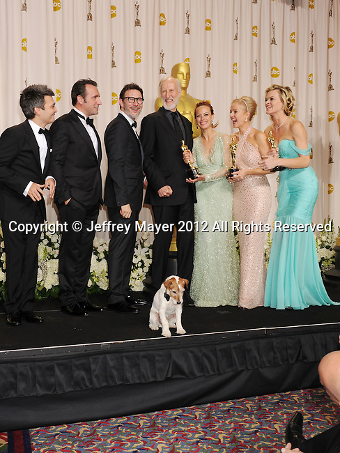 HOLLYWOOD, CA - FEBRUARY 26: Thomas Langmann, Jean Dujardin, Michel Hazanavicius, James Cromwell, Uggie the dog, Berenice Bejo, Penelope Ann Miller and Missi Pyle pose in the press room at the 84th Annual Academy Awards held at Hollywood & Highland Center on February 26, 2012 in Hollywood, California.