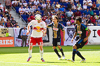 Kenny Cooper (33) of the New York Red Bulls shoots and scores his second goal of the game. The New York Red Bulls defeated the Philadelphia Union 2-0 during a Major League Soccer (MLS) match at Red Bull Arena in Harrison, NJ, on July 21, 2012.