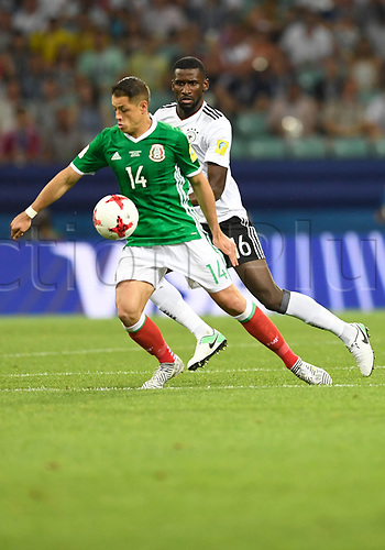 "29th June 2017, Sochi, Russia;  Antonio Ruediger (R) from Germany and Javier Hernandez ""Chicharito"" from Mexico challenge for the ball during the semi-final of the Confederations Cup between Germany and Mexico at the Fisht Stadium in Sochi, Russia"