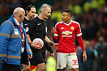 Jesse Lingard of Manchester United speaks with referee Martin Atkinson at full time during the Emirates FA Cup match at Old Trafford. Photo credit should read: Philip Oldham/Sportimage