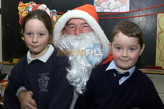 Patrica McGuigan and Martin Mullen pictured with Santa at Termonfeckin national school.