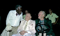 Winston-Salem, North Carolina, USA, May 31,1991<br /> Bob Hope and Former President Gerald R. Ford sit in a golf cart while greeting fans and guests at the annual Bill Crosby Clambake Golf Tournament at the Bermuda Run Country Club. Jazz singer Joe WIlliams greets Hope and Ford Credit: Mark Reinstein/MediaPunch