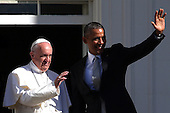 U.S. President Barack Obama (R) and Pope Francis (L) wave during an arrival ceremony at the White House on September 23, 2015 in Washington, DC. The Pope begins his first trip to the United States at the White House followed by a visit to St. Matthew's Cathedral, and will then hold a Mass on the grounds of the Basilica of the National Shrine of the Immaculate Conception.<br /> Credit: Win McNamee / Pool via CNP