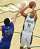 Zed Key #14 of Brentwood, right, pulls up for a jumper during a game against Copiague in the Gary Charles Hoop Classic at Adelphi Unversity on Sunday, Jan. 8, 2017. He recorded 26 points, nine rebounds and three blocks in Brentwood's 65-61 win.