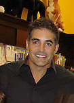 """Cast of Days Of Our Lives - Galen Gering """"Rafe Hernandez"""" sign sbook """"Days Of Our Lives 50 Years"""" by Greg Meng - author & co-executive producer on October 27, 2015 at Books & Greetings, Northvale, New Jersey. (Photo by Sue Coflin/Max Photos)"""