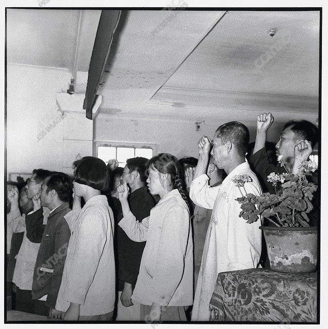 In a middle-school meeting room, new members of the Communist Party take the oath in front of a bust of Mao and the hammer and sickle of the communist flag. Acheng, Acheng county, 1 July 1965