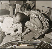 BNPS.co.uk (01202 558833)<br /> Pic: PhilYeomans/BNPS<br /> <br /> Stirling Moss plays with the original Scalextric.<br /> <br /> These fascinating photos tell the story of 60 years of Scalextric which grew from humble beginnings into a British institution. <br /> <br /> When enterprising Freddie Francis launched the car racing toy in 1957 at his factory in Havant, Hants, he could never have known they would still be a household name 60 years later.<br /> <br /> Today, Scalextric are produced by English toy maker Hornby Hobbies and demand for the much-loved slot cars is still as strong as ever.
