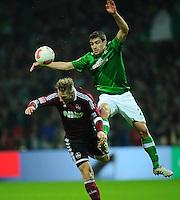 FUSSBALL   1. BUNDESLIGA    SAISON 2012/2013    17. Spieltag   SV Werder Bremen - 1. FC Nuernberg                     16.12.2012 Sokratis Papastathopoulos (SV Werder Bremen) gegen Sebastian Polter (re, 1 FC Nuernberg)