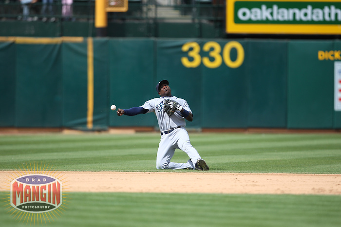 OAKLAND, CA - SEPTEMBER 20:  Yuniesky Betancourt of the Seattle Mariners makes a throw from shortstop during the game against the Oakland Athletics at the McAfee Coliseum in Oakland, California on September 20, 2008.  The Athletics defeated the Mariners 8-7.  Photo by Brad Mangin