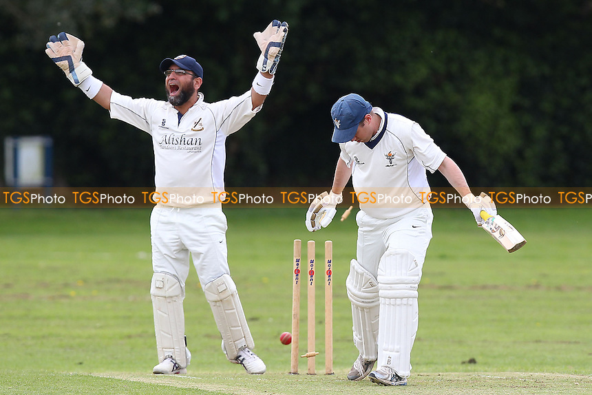 Andy Berry takes the second Chingford wicket as Freddie Butt looks on - Upminster CC vs Chingford CC - Essex Cricket League Cup - 26/04/14 - MANDATORY CREDIT: Gavin Ellis/TGSPHOTO - Self billing applies where appropriate - 0845 094 6026 - contact@tgsphoto.co.uk - NO UNPAID USE