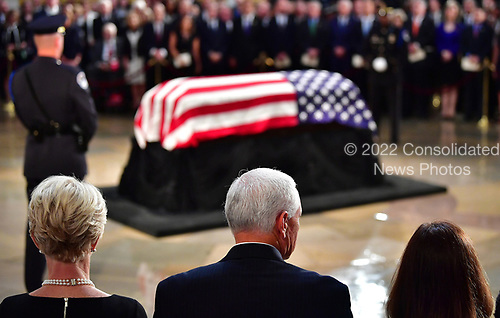 Vice President Mike Pence (C) his wife Karen (R) and City McCain, the widow of Sen. John McCain, R-Ariz., stand during McCain's memorial service in the Capitol Rotunda where he will lie in state at the U.S. Capitol, in Washington, DC on Friday, August 31, 2018. McCain, an Arizona Republican, presidential candidate, and war hero, died August 25th at the age of 81. He is the 31st person to lie in state at the Capitol in 166 years. Photo Ken Cedeno/UPI