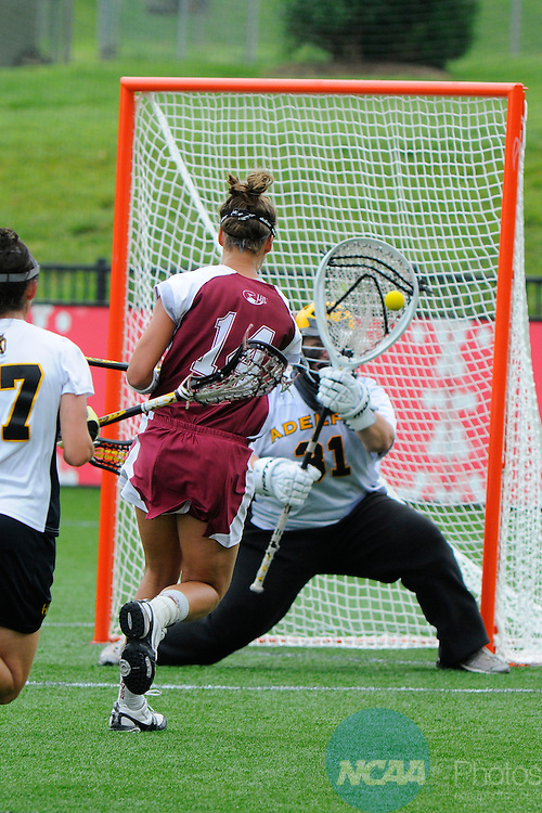 17 MAY 2009:  Adelphi University's goalie Caitlin Fitzpatrick (31) blocks a goal by Elyse Fisher (14) of Lock Haven University during the Division II Women's Lacrosse Championship held at Spartan Field in Salem, VA.  Adelphi defeated Lock Haven 16-4 to win the national title.  Andres Alonso/NCAA Photos