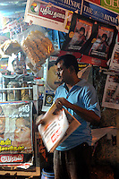 A man in front of magazine shop in Madras, India