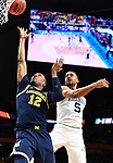 SAN ANTONIO, TX - APRIL 02:  Muhammad-Ali Abdur-Rahkman #12 of the Michigan Wolverines shoots the ball against Phil Booth #5 of the Villanova Wildcats during the second half in the 2018 NCAA Men's Final Four National Championship game at the Alamodome on April 2, 2018 in San Antonio, Texas.  (Photo by Brett Wilhelm/NCAA Photos via Getty Images)