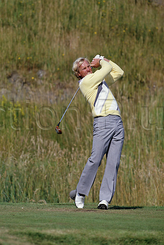 July 1986: Australian golfer Greg Norman (AUS) plays a shot from the tee during the Open Championship at Turnberry, England. Photo: Tony Henshaw/actionplus...8607 golf man male british major