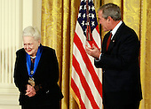 Washington, DC - November 17, 2008 -- United States President George W. Bush congratulates actress Olivia de Havilland after presenting her with the 2008 National Medals of Arts award during an event in the East Room at the White House on Monday, November 17, 2008 in Washington, DC. During the event president Bush presented recipients with awards for the National Medals of Arts and the National Humanities Medal.  .Credit: Mark Wilson - Pool via CNP
