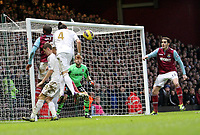 Barclays Premier League, West Ham United (red)V Swansea City Fc (white), Boelyn Ground, 02/02/13<br /> Pictured: Chico Flores has a header at the West Ham goal<br /> Picture by: Ben Wyeth / Athena Picture Agency<br /> info@athena-pictures.com