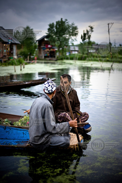 Boatmen selling vegetables on the floating market on Dal Lake.