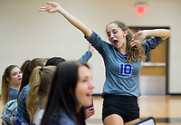 NWA Democrat-Gazette/CHARLIE KAIJO Rogers High School outside hitter Taylor Voight (10) cheers on teammates during the girl's volleyball game on Thursday, October 12, 2017 at Bentonville West High School in Centerton.
