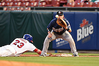 Gwinnett Braves first baseman Joey Terdoslavich (7) takes a pickoff attempt throw as Brett Carroll (23) dives back safely during a game against the Buffalo Bisons on May 13, 2014 at Coca-Cola Field in Buffalo, New  York.  Gwinnett defeated Buffalo 3-2.  (Mike Janes/Four Seam Images)