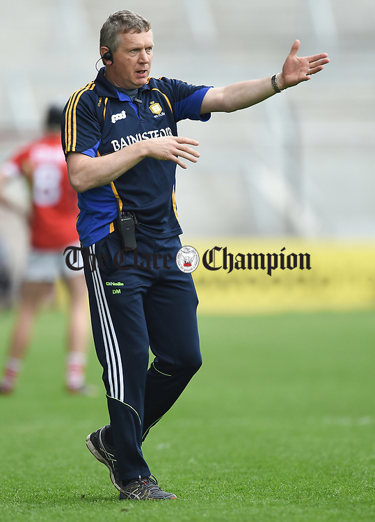 Donal Moloney, Clare joint manager issues instructions to players during their Munster Senior game at Pairc Ui Chaoimh. Photograph by John Kelly.