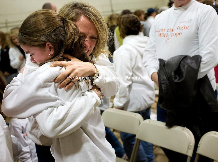 CHESHIRE, CT--06 January 08--010608TJ02 - LInda Witkowski hugs Katheryn Thompson, 11, both from Cheshire and friends of the Petits, at a gathering at Bozzuto's Warehouse in Cheshire, Conn., before volunteers delivered luminarias to be lit around Cheshire on Sunday, January 6, 2008. More than 140,000 luminarias were placed along Routes 10 and 70, and in neighborhoods in Cheshire, through the town's Lights of Hope fundraiser for the Connectecut chapter of the National MS Society, and in honor of Jennifer Hawke-Petit and her daughters Hayley and Michaela, who were killed in a home invasion in July of 2007. T.J. Kirkpatrick/Republican-American