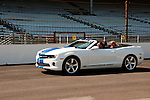 USA, Indiana, Indianapolis Motor Speedway, fan rides in pace cars during off season scene of the annual Indy 500 car race.