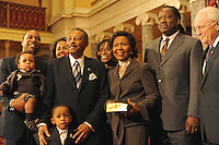 Senator Roland Burris poses for a photograph with his wife Berlean Burris and members of his family and with Vice President Dick Cheney after he is sworn in to the U.S. Senate in the old Senate chamber of the U.S. Senate in Washington, DC on January 15, 2008.