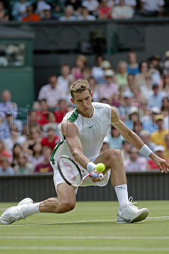 30 June 2006: Belarus player Max Mirnyi (BLR) plays a forehand drop volley during his third round men's singles match against Blake on the fifth day at the All England Lawn Tennis Championships, Wimbledon, London. Mirnyi won the match 6-4, 3-6, 4-6, 6-1, 6-0 Photo: Glyn Kirk/Actionplus...060630 man men male ball racket belarusian belarussian