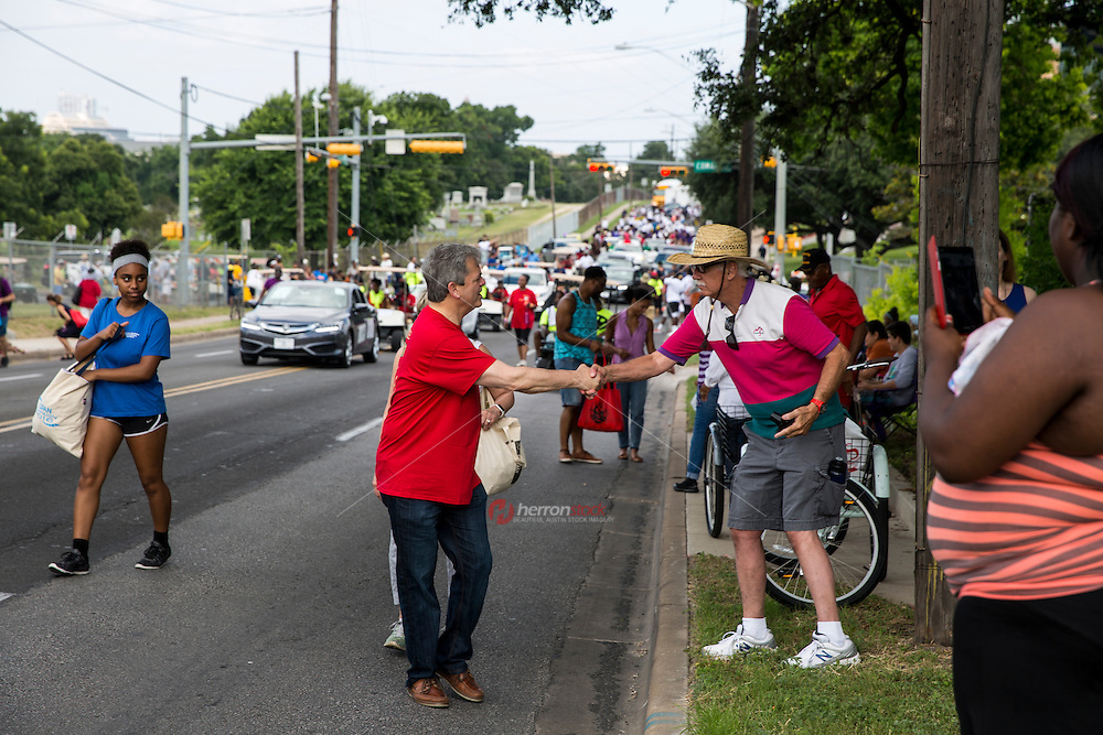 AUSTIN, TEXAS - Austin Mayor, Steve Adler shakes hands of crowds and residents attending the 2016 Central Texas Juneteenth Celebration Parade on Sat. June 18, 2016<br /> <br /> Use of this image in advertising or for promotional purposes is prohibited.<br /> <br /> Editorial Credit: Dan Herron / Herronstock Editorial.