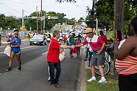 AUSTIN, TEXAS - Austin Mayor, Steve Adler shakes hands of crowds and residents attending the 2016 Central Texas Juneteenth Celebration Parade on Sat. June 18, 2016<br />