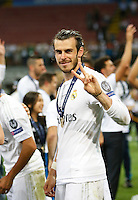 Calcio, finale di Champions League: Real Madrid vs Atletico Madrid. Stadio San Siro, Milano, 28 maggio 2016.<br /> Real Madrid&rsquo;s Gareth Bale celebrates at the end of the Champions League final match against Atletico Madrid, at Milan's San Siro stadium, 28 May 2016. Real Madrid won 5-4 on penalties after the game ended 1-1.<br /> UPDATE IMAGES PRESS/Isabella Bonotto