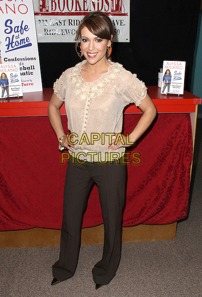 "ALYSSA MILANO.Book Signing for  ""Safe at Home: Confessions of a Baseball Fanatic"" held at Bookends Book Store, Ridgewood, New Jersey, USA, .31st March 2009..full length cream beige top ruffle sheer trousers hands on hips brown buttons blouse .CAP/ADM/PZ.©Paul Zimmerman/Admedia/Capital Pictures"