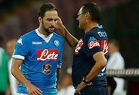 Napoli's coach  Maurizio Sarri and Napoli's Gonzalo Higuain  during the  italian serie a soccer match against   Juventus,    at  the San  Paolo   stadium in Naples  Italy , September 26 , 2015