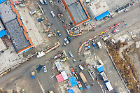 A busy shopping market and crossroads in Nanbao village, Hebei Province. China, 2019.