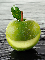 Wole Granny Smith apple  with a smiley face