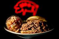 Small business photography of Troutman's Barbecue, a popular bbq restaurant in downtown Concord, North Carolina. Image shows the BBQ sandwich special with Troutmans famous red, vinegar-based slaw. Photo is part of a photographic series of images featuring Concord, NC, by photographer Patrick Schneider..
