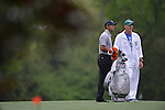 AUGUSTA, GA - APRIL 11: Tiger Woods prepares to hit off the fairway during the First Round of the 2013 MAsters Golf Tournament at Augusta National Golf Club on April 10in Augusta, Georgia. (Photo by Donald Miralle) *** Local Caption ***