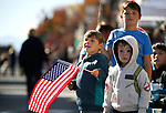 From left, Josiah Jackson, 5, Abel Manse, 4, and Jayen Jackson, 8, watch the Nevada Day parade in Carson City, Nev., on Saturday, Oct. 26, 2019.  <br /> Photo by Cathleen Allison/Nevada Momentum