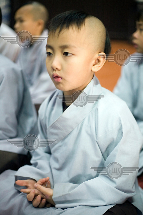 Young monks chant sutras at the monastery at the Thienmu Pagoda.