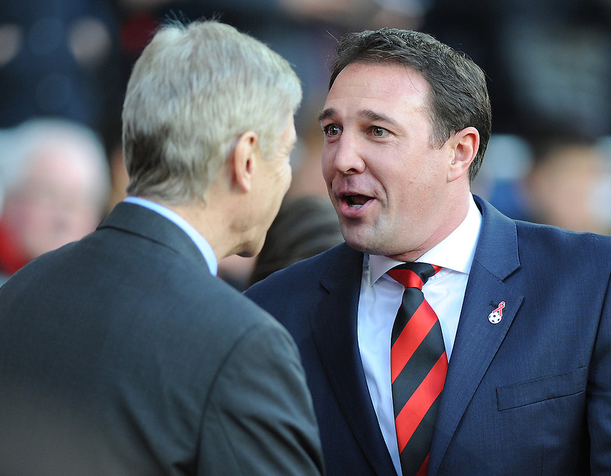 Arsenal's Manager Arsene Wenger  and Cardiff City's Manager Malky Mackay exchange words before the game <br /> <br /> Photo by Ashley Crowden/CameraSport<br /> <br /> Football - Barclays Premiership - Cardiff City v Arsenal - Saturday 30th November 2013 - Cardiff City Stadium - Cardiff<br /> <br /> &copy; CameraSport - 43 Linden Ave. Countesthorpe. Leicester. England. LE8 5PG - Tel: +44 (0) 116 277 4147 - admin@camerasport.com - www.camerasport.com